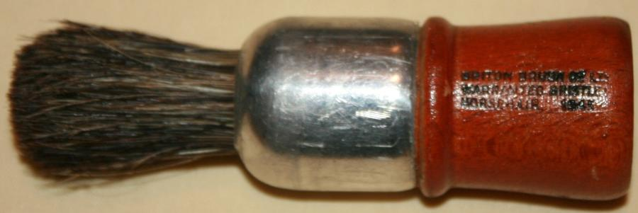 A 1945 DATED SHAVING BRUSH