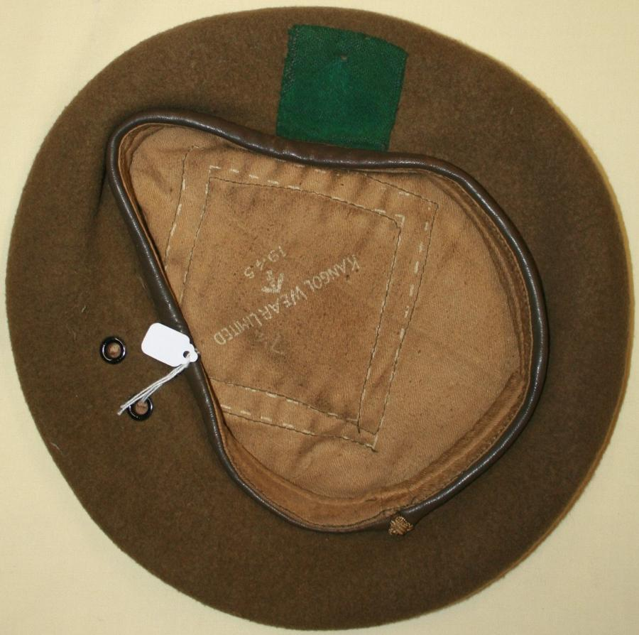 A 1945 DATED GREEN / BROWN BERET