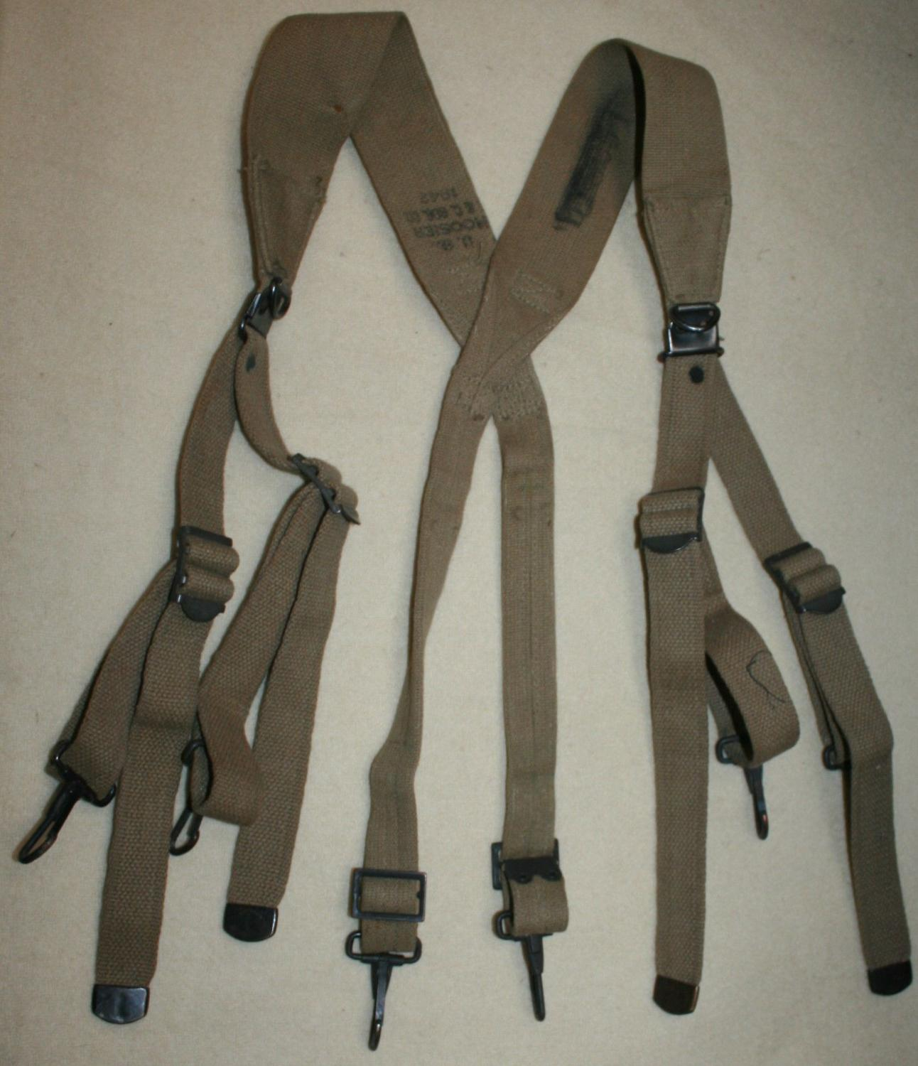 A GOOD USED PAIR OF M1928 SUSPENDERS 1942 DATED