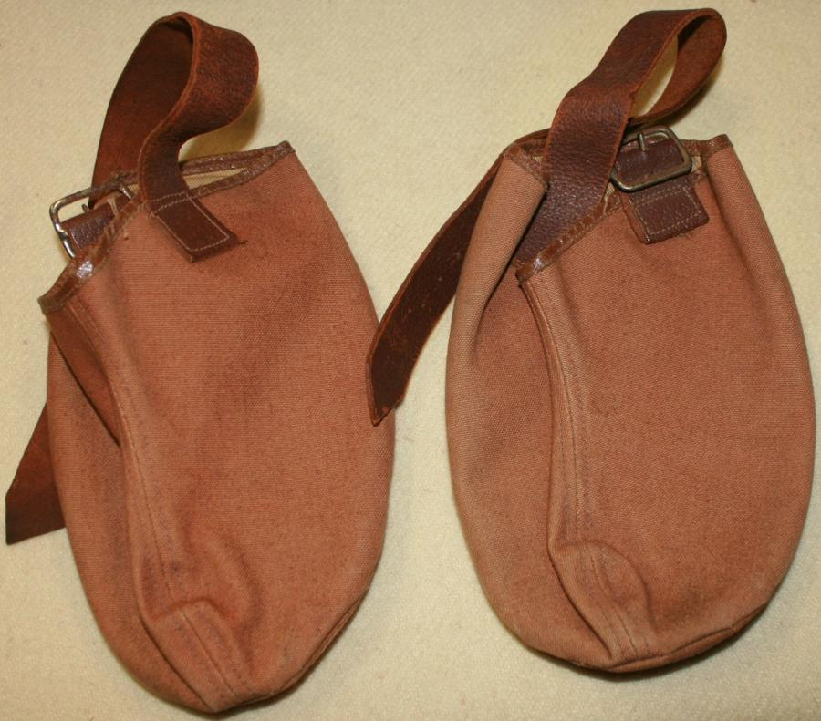 A PAIR OF 1941 DATED BOOT ANTI SLIP COVERS