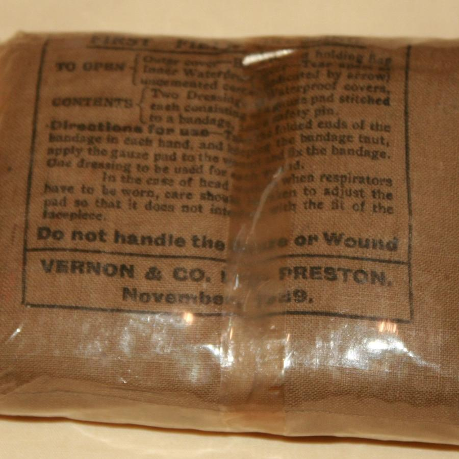 A 1939 DATED 1ST FILED DRESSING IN ITS CELLOPHANE WRAPPER
