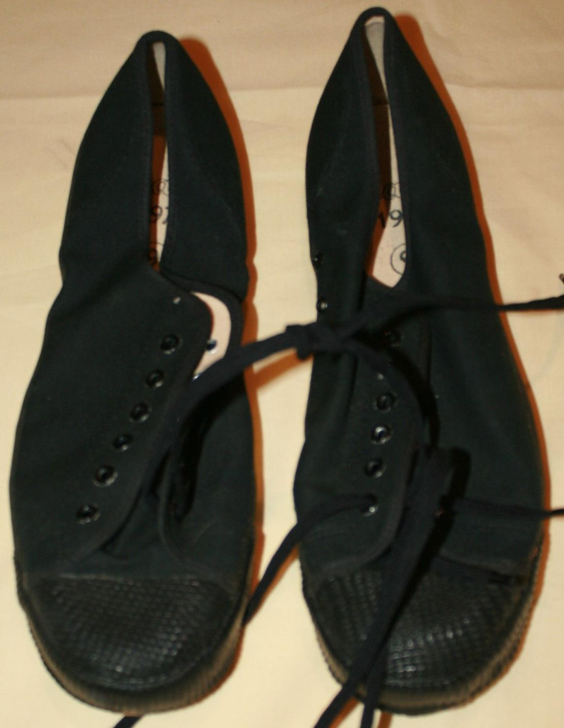 A MINT PAIR OF 1970 DATED BLACK PLIMSOLLS