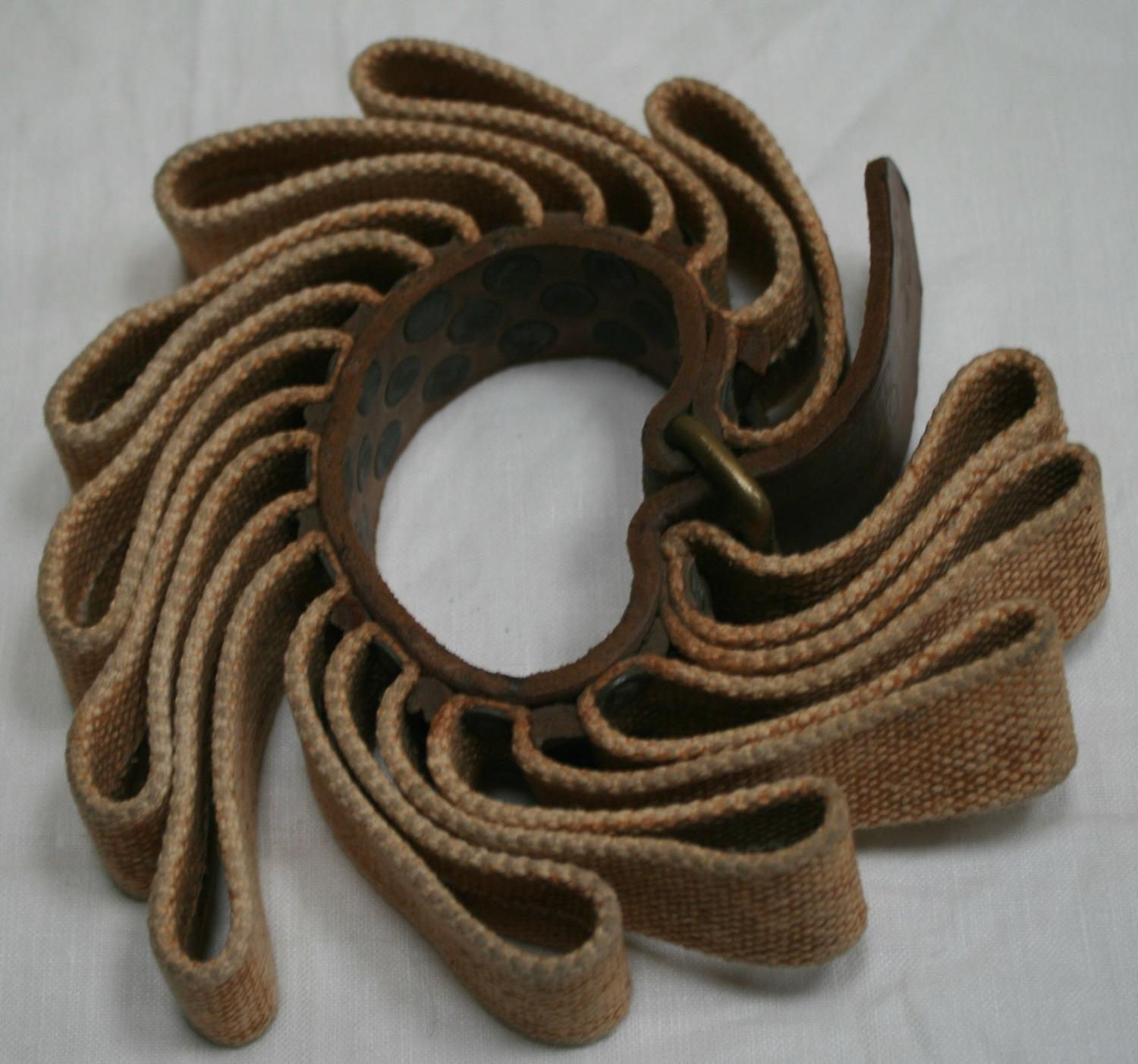 A 1940 DATED TENT POLE RIFLE RING