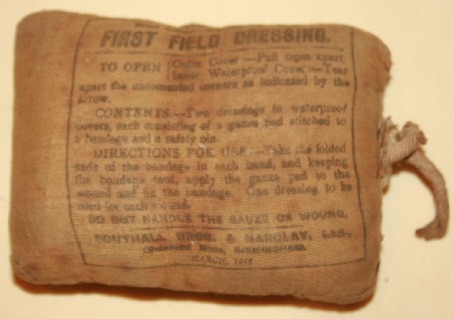 A WWI 1ST FIELD DRESSING 1918 DATED