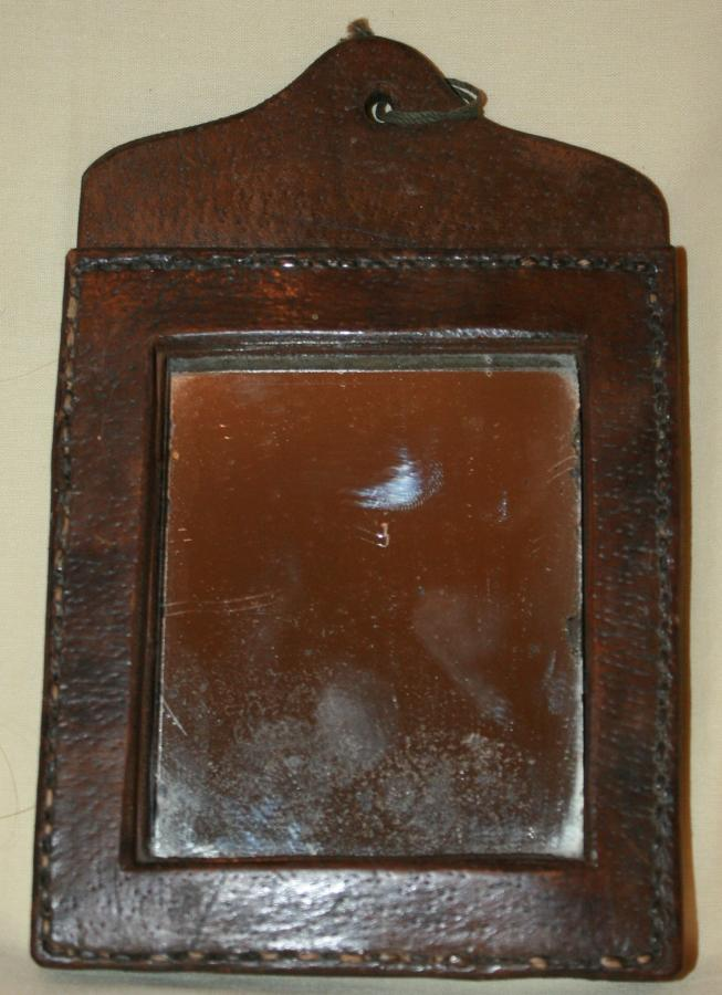 A WWI OR EARLIER LEATHER MOUNTED MIRROR