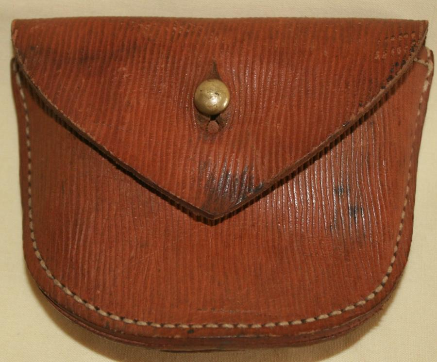 A 1917 DATED PISTOL AMMO POUCH LOOP TYPE FITTING
