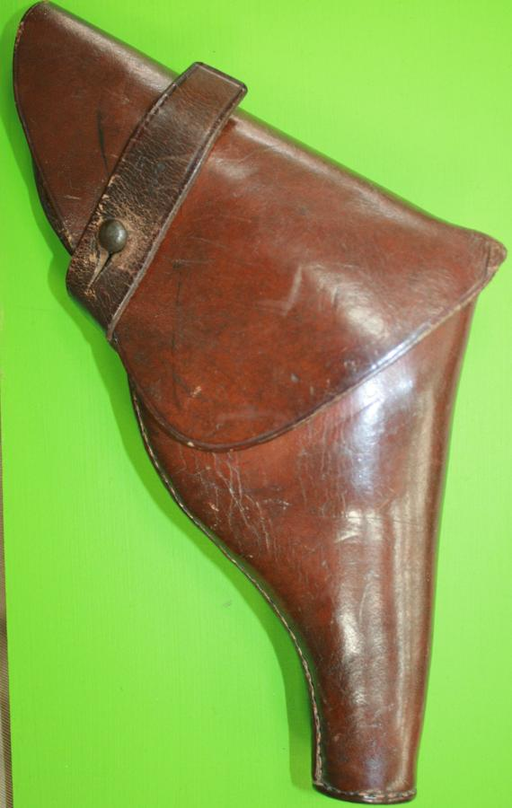 A 1916 DATED PRIVATE PISTOL HOLSTER MADE BY HGR SMALL SIZE