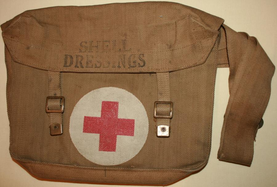 A GOOD USED WWII SHELL DRESSING BAG 1942 DATED