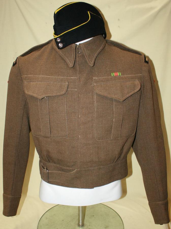 A WWII NEW ZEALAND MADE HAMPSHIRE REGT BATTLE DRESS JACKET