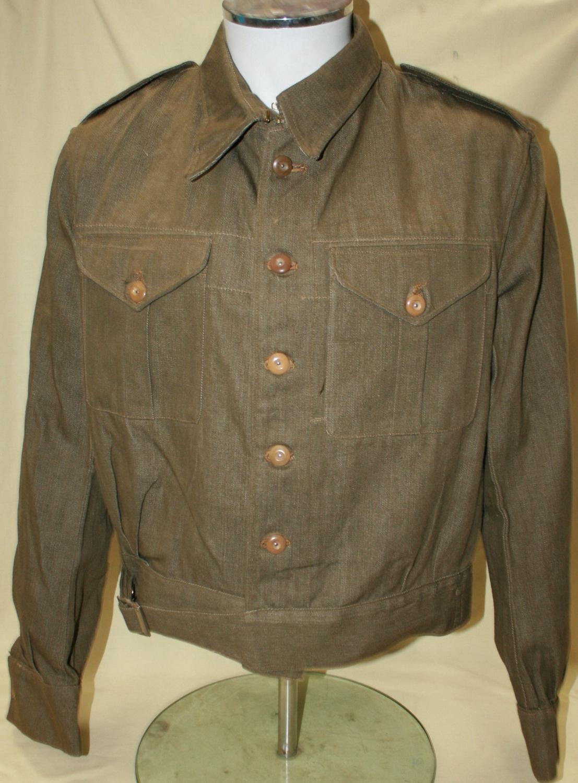 A 1940 DATED MINT DENIM BATTLE DRESS JACKET