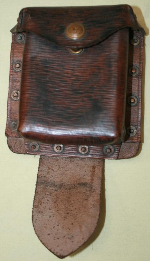 A 39 PATTERN LEATHER EQUIPMENT PISTOL AMMO POUCH WITH ITS REAR STRAP