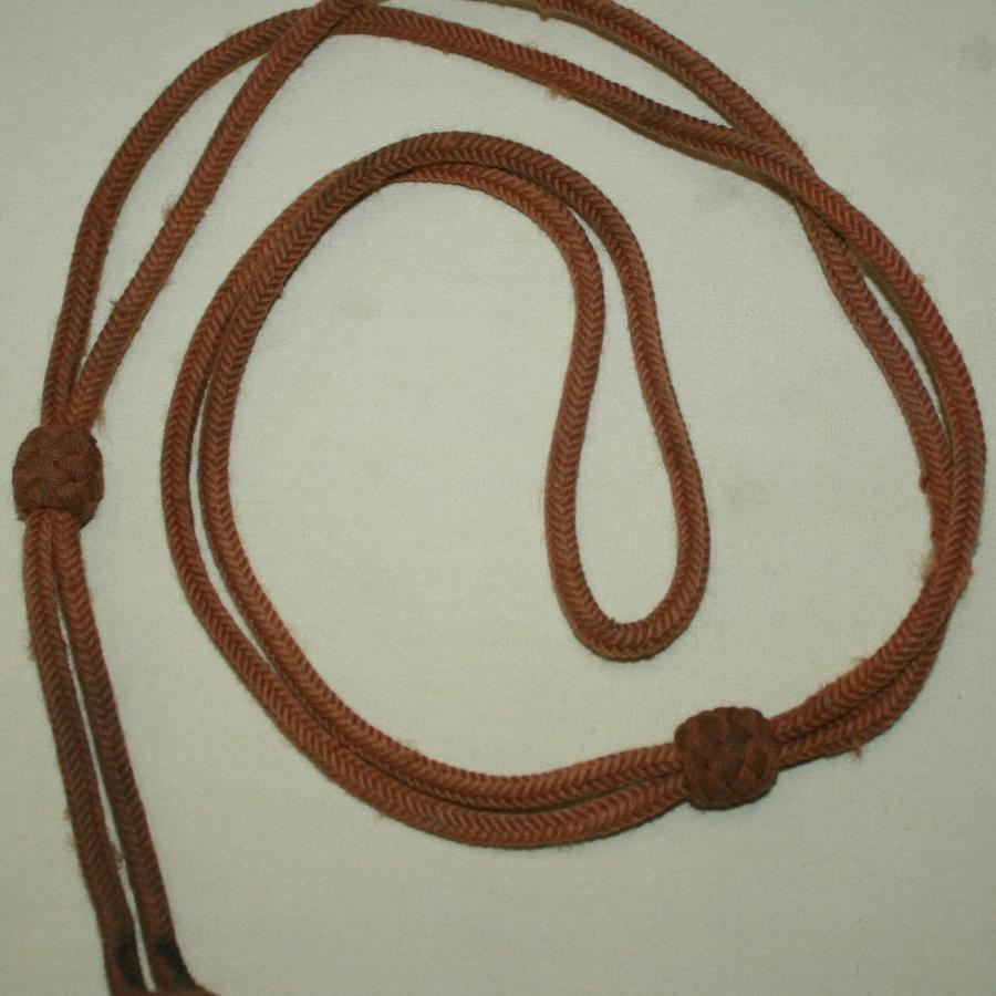 A WWI GOOD USED PISTOL LANYARD
