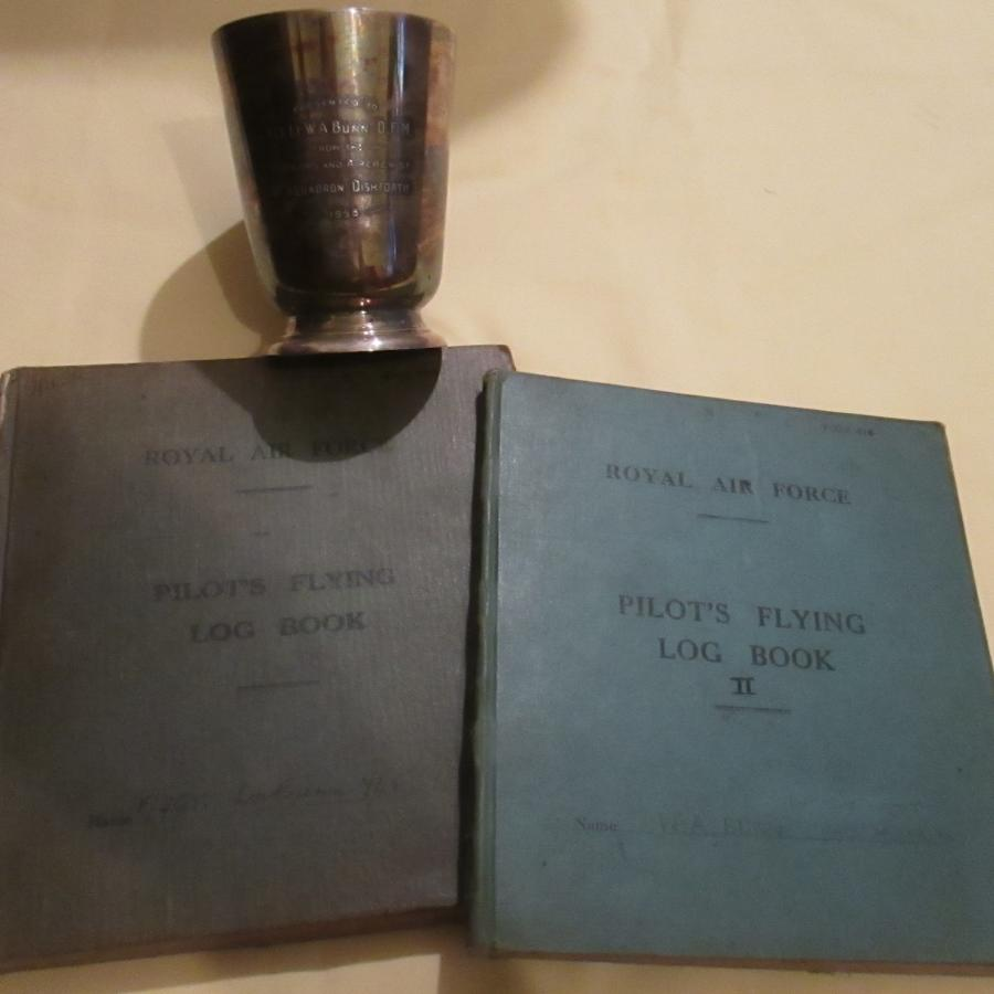 A GOOD PAIR OF WWII RAF LOG BOOKS TO W A DUNN FLT SGT RAFVR 32 + OPPS
