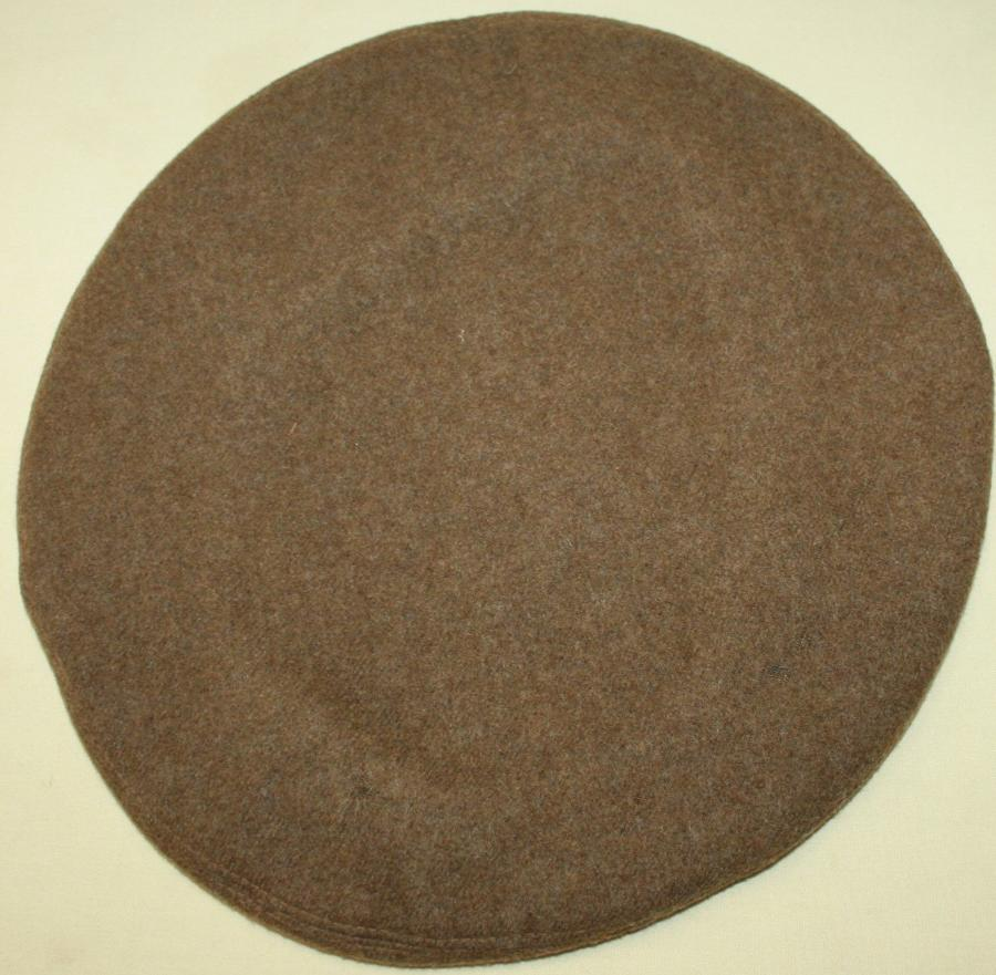 A 1945 DATED GS BERET SIZE 7 1/4