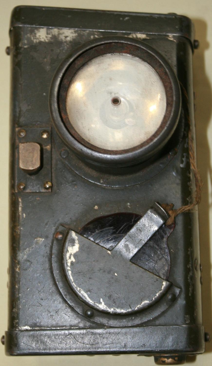 A WWI TRENCH SIGNALLING LAMP WITH A BAYONET FITTING