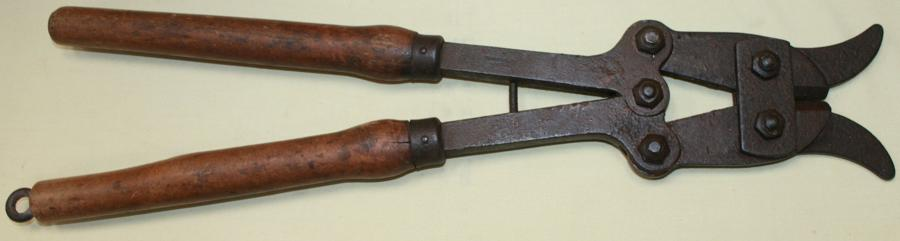 A PAIR OF BRITISH WOOD HANDLED LONG WIRE CUTTERS