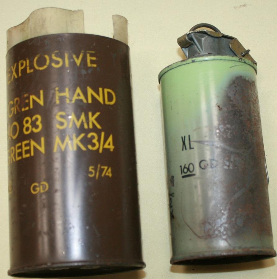 A GREEN USED SMOKE GRENADE 1970'S EXAMPLE WITH ITS TIN