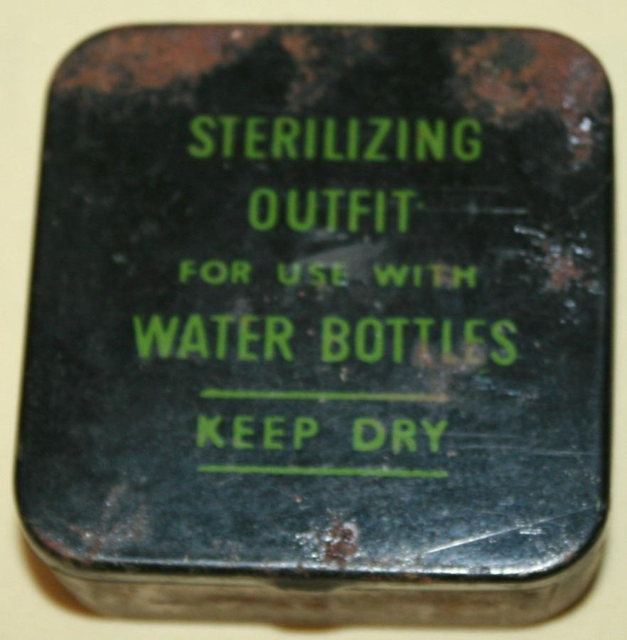 A EARLY WAR WATER BOTTLE STERILISING OUT FIT