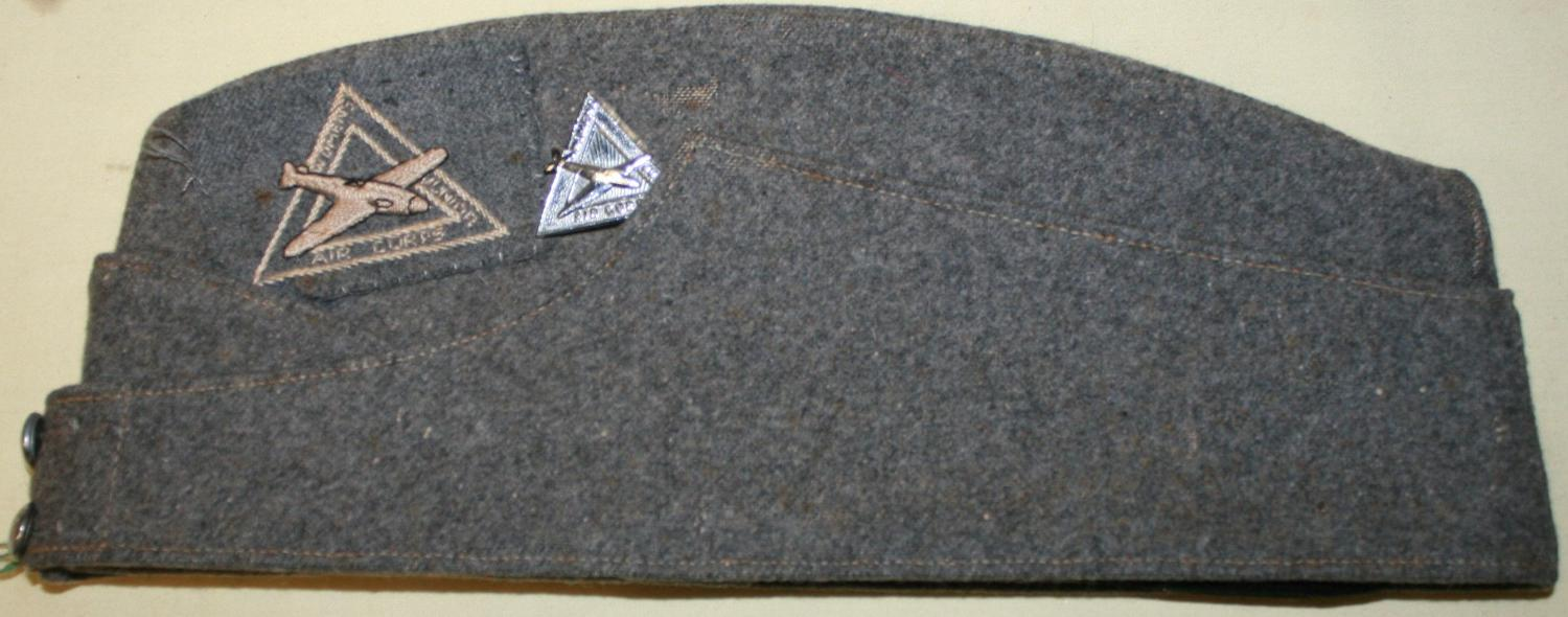 A WWII JUNIOR WOMAN'S AIR TRAINING CORPS SIDE CAP AND BADGE