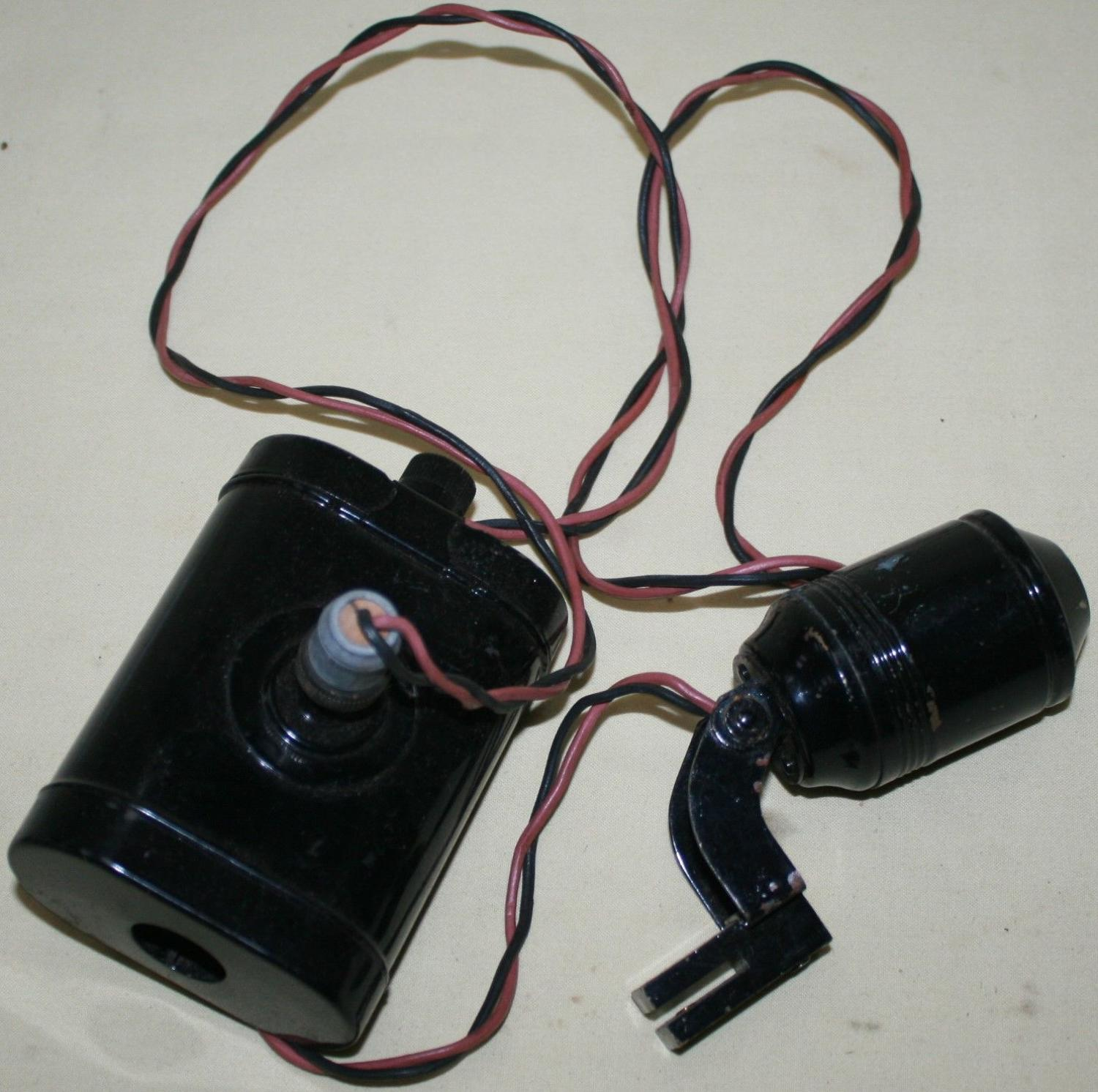 A WWII ARP SERVICES HELMET LAMP AND BATTERY PACK