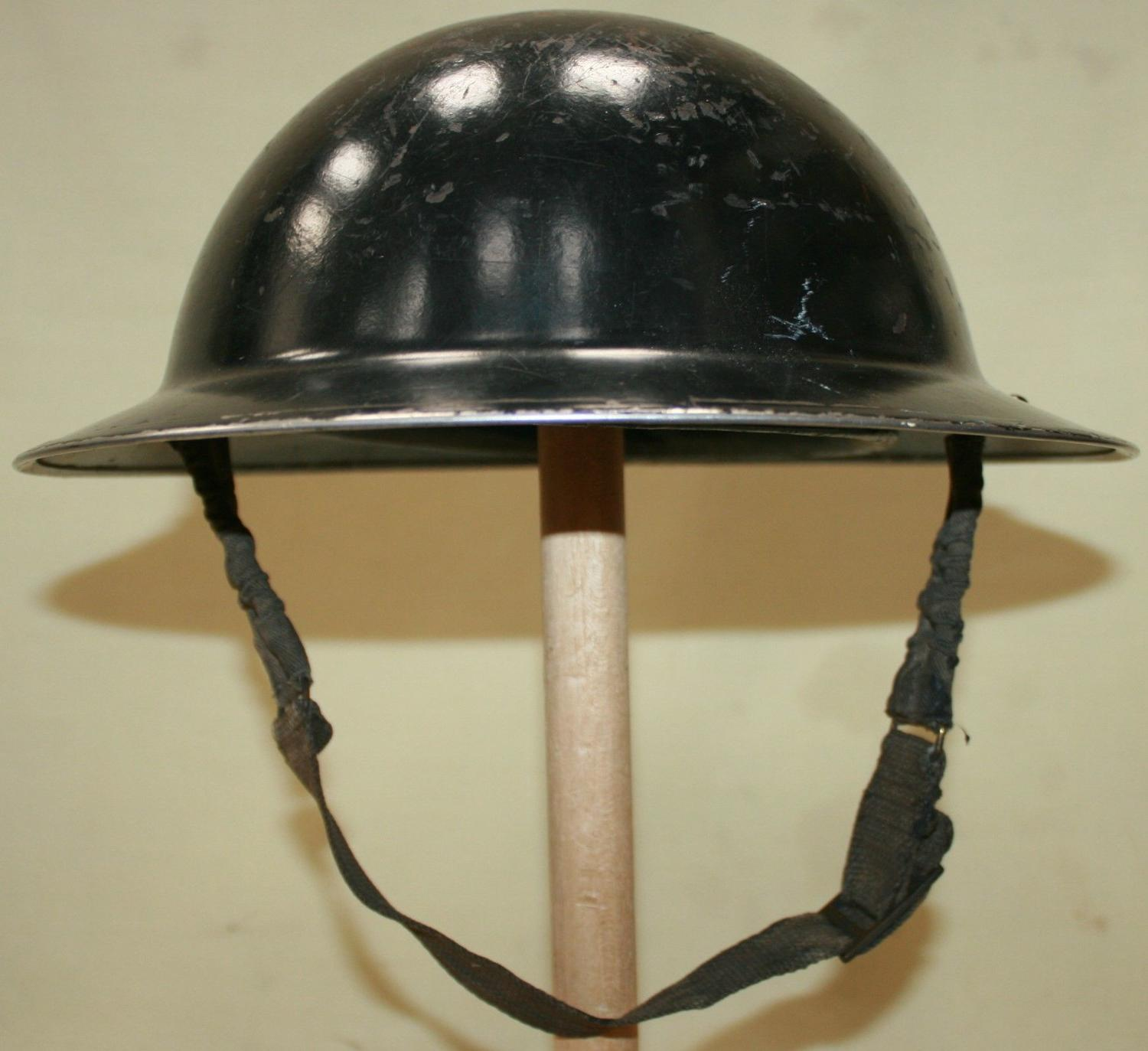 A WWII WARDENS HELMET 1939 DATED
