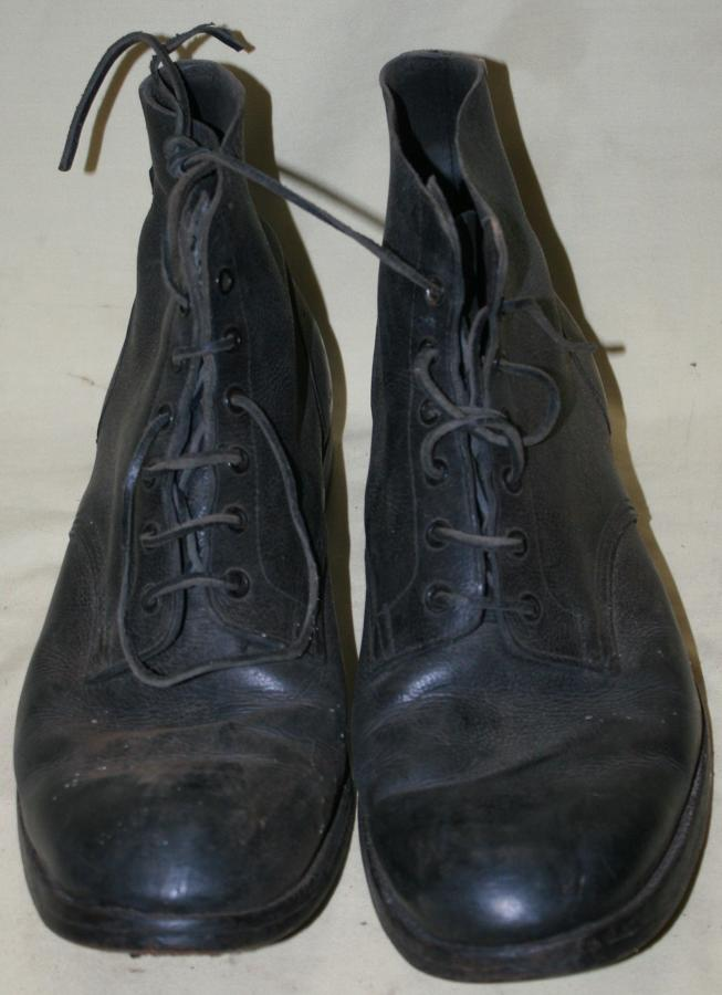 A PAIR OF 1944 DATED NAVY ISSUE BOOTS SIZE 11