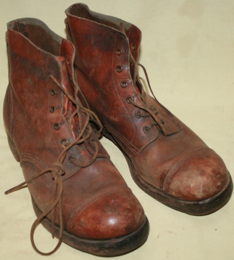 A GOOD USED PAIR OF 1944 DATED JUNGLE BOOTS SIZE 9 M