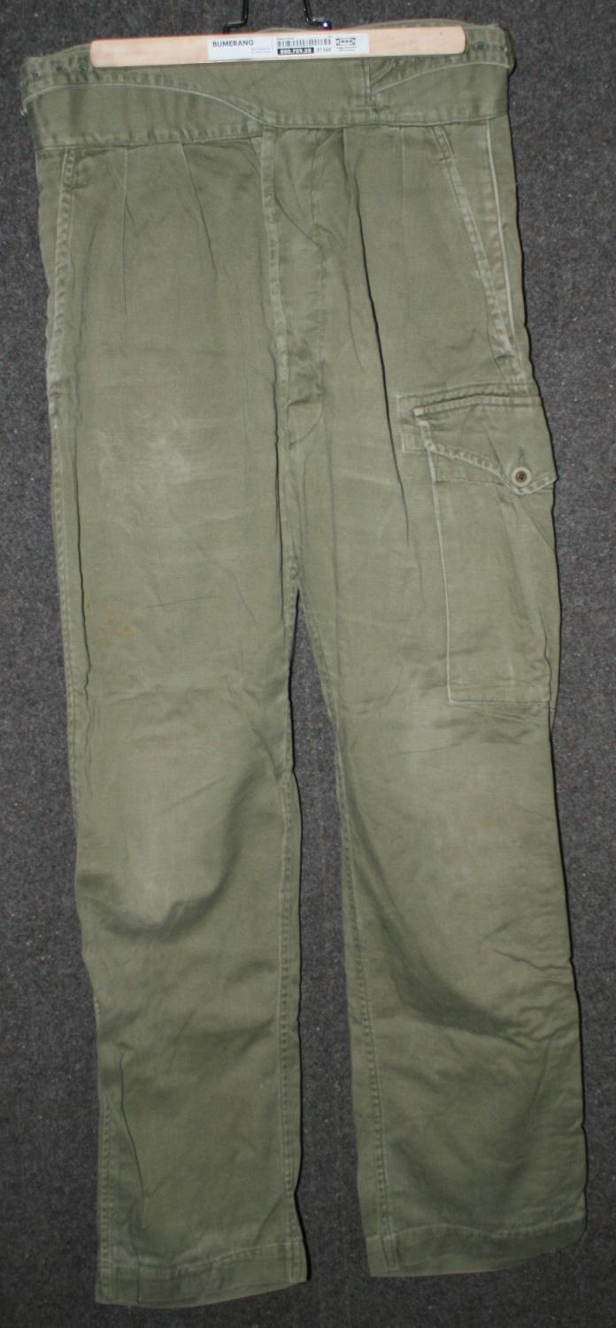 A PAIR OF THE WRAP AROUND POST WAR JUNGLE GREEN TROUSERS