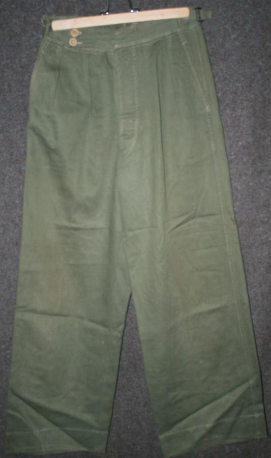 A WWII PATTERN PAIR OF JUNGLE GREEN TROUSERS