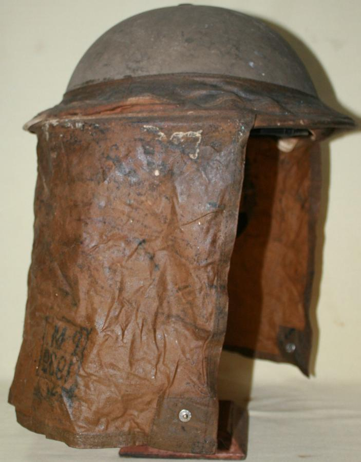 A GOOD SCARCE EXAMPLE OF THE EARLY WWII BEF GAS HOOD AND HELMET