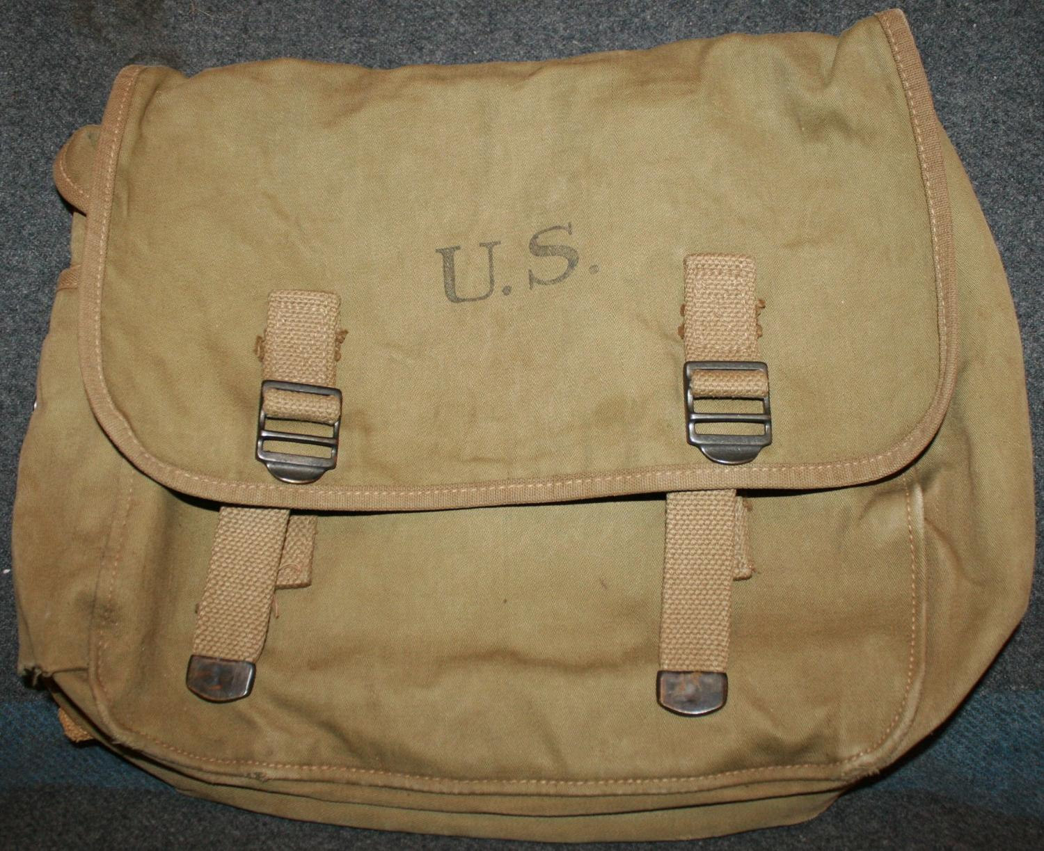 A GOOD USED EARLY WWII 1940 DATED US ARMY MUSSET BAG AND STRAP