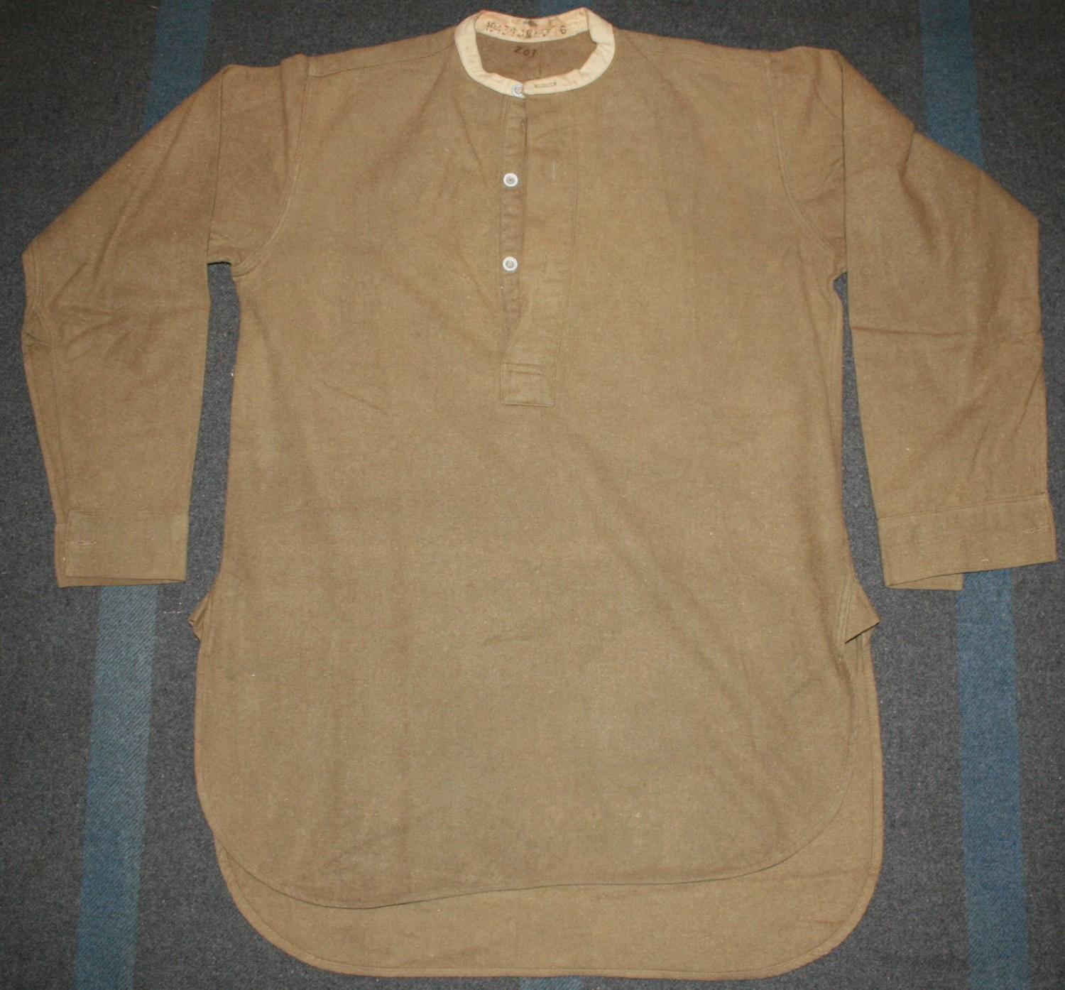 A GOOD LARGE SIZE 1943 DATED COLLARLESS SHIRT SIZE 6