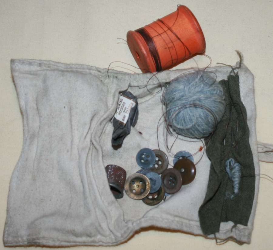 A USED WWII PERIOD HOUSEWIFE SEWING KIT