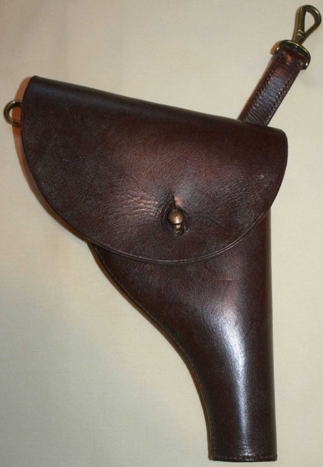 A LEATHER SAM BROWN HANGING PISTOL CASE