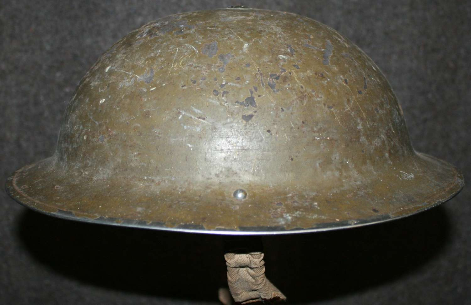 A 1938 DATED GREEN TOMMY HELMET HOMEFRONT WOLSTON EMERGENCY HOSPITAL