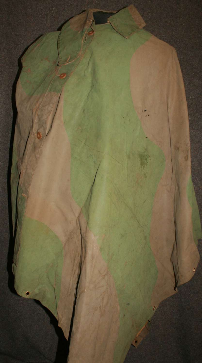 A WELL USED EARLY WAR CAMOUFLAGE CAPE