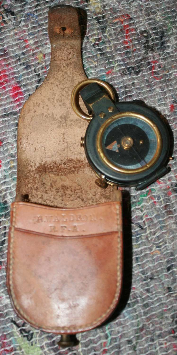 A OFFICERS PRIVATE PURCHASE WWII COMPASS AND CASE NAMED