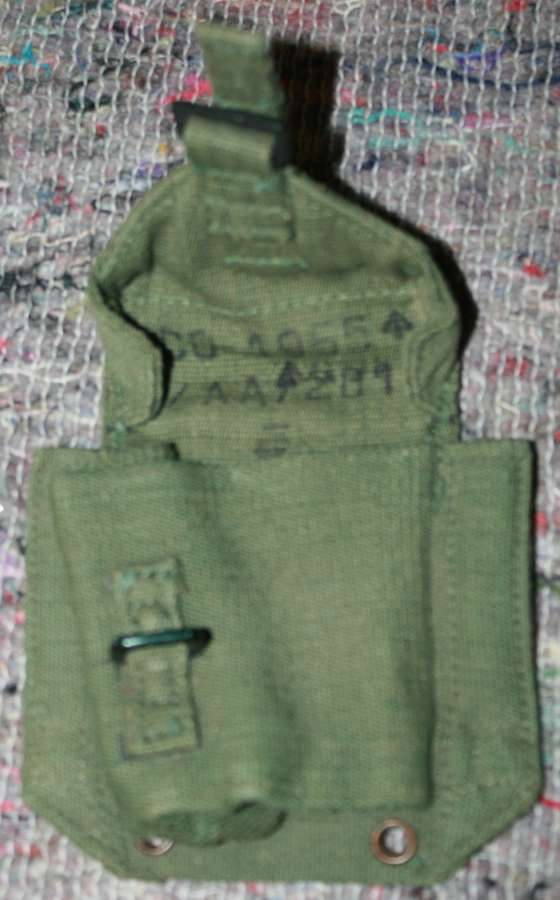 A 1955 DATED 44 PATTERN WEBBING PISTOL AMMO POUCH