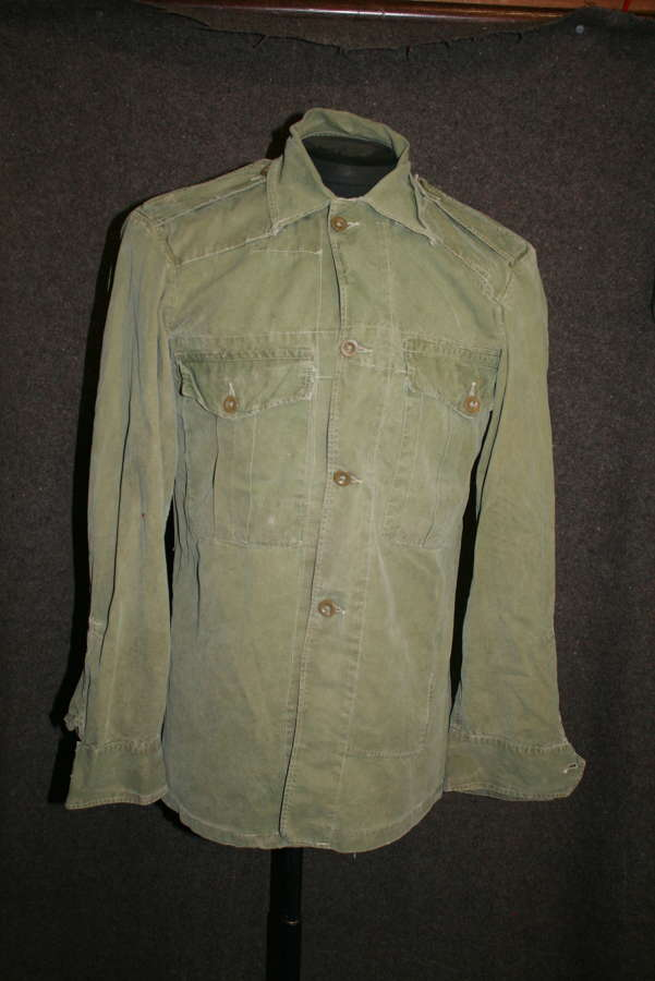 A WWII PERIOD 44 PATTERN JUNGLE BUSH JACKET