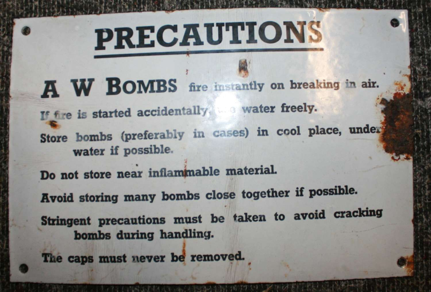 A WWII AW BOMB SIGN