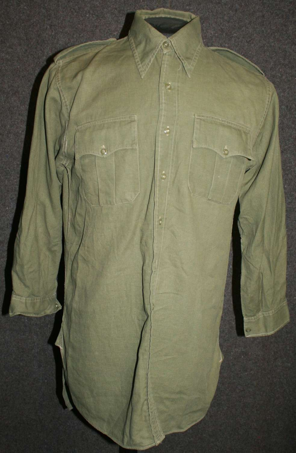 A EARLY POST WWII GREEN JUNGLE BUSH SHIRT