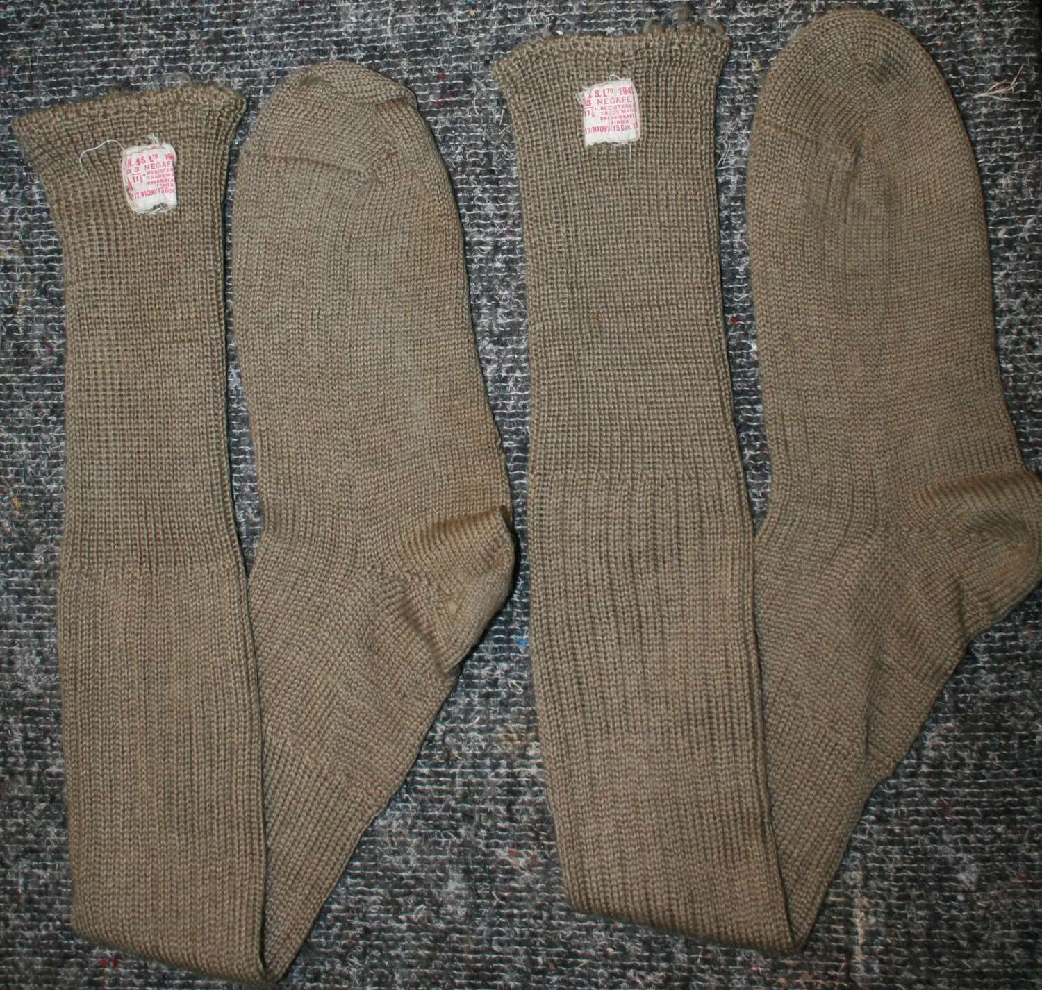 A PAIR OF KNEE LENGTH ARMY SOCK 1945 DATED