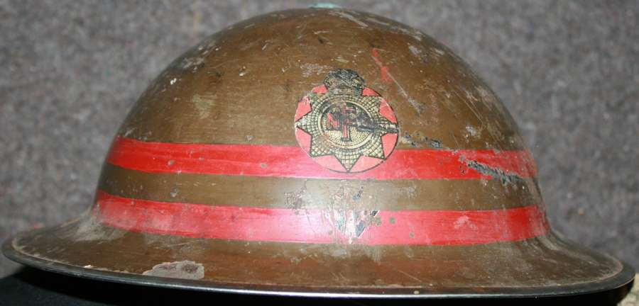A WWII 2 RED BANDED NFS FACTORY STEEL HELMET