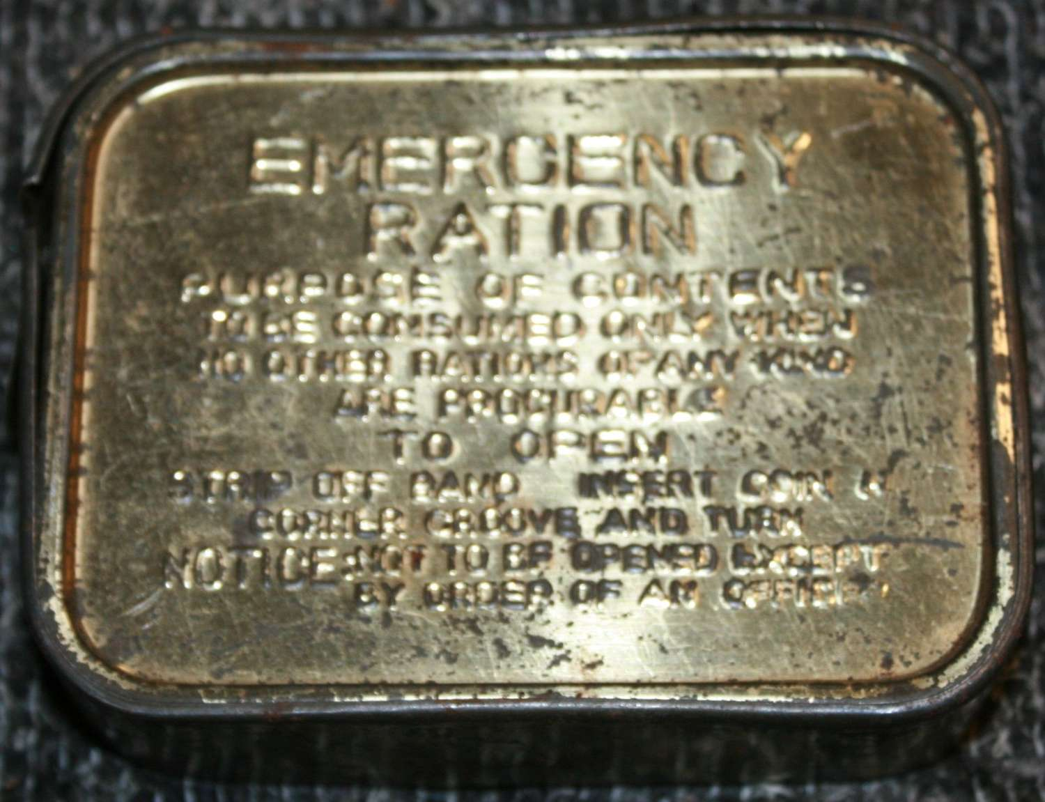 A WWII EMERGENCY RATION TIN WITH THE OUTER BAND