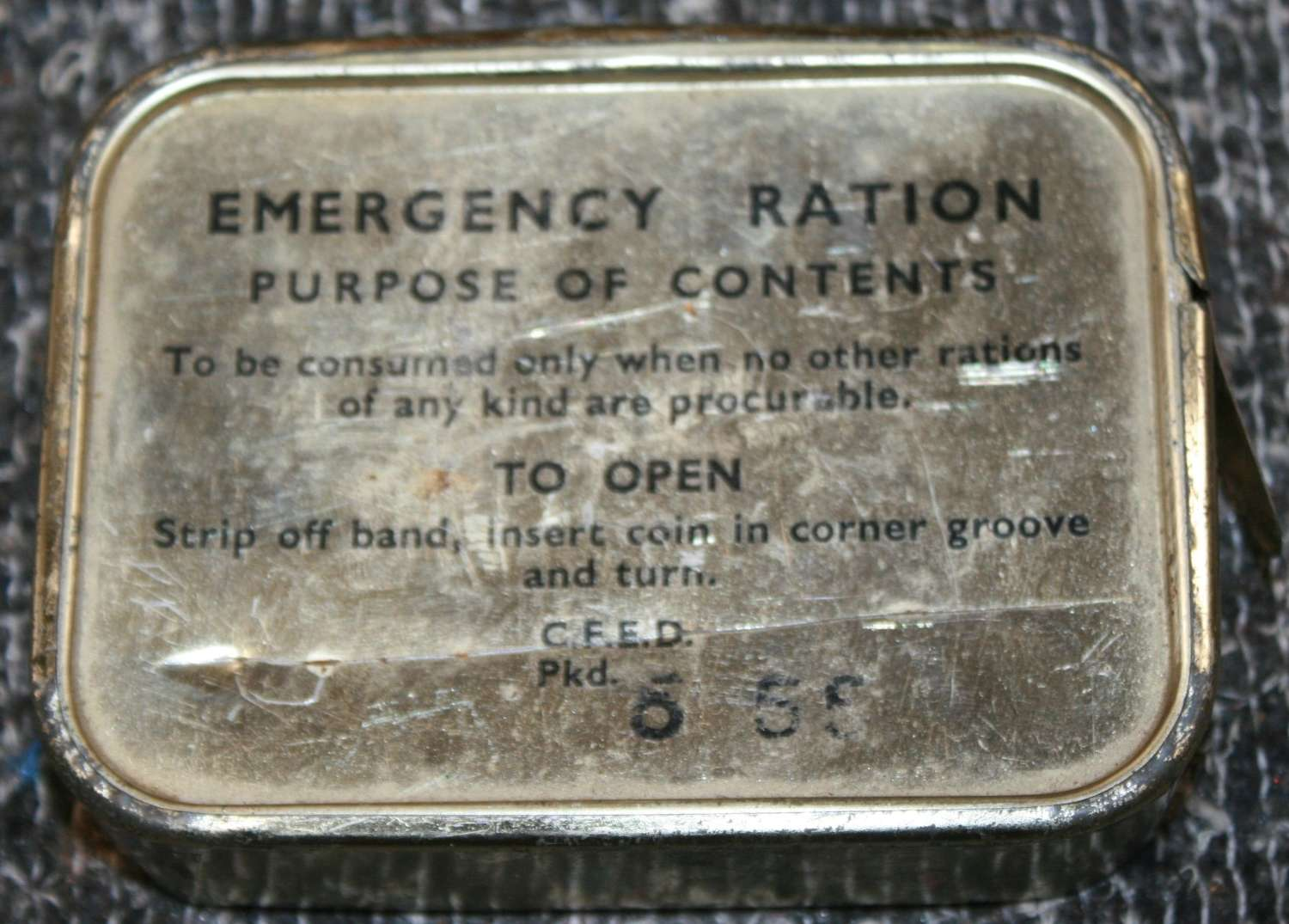 A 1950'S EMERGENCY RATION TIN FULL UNOPENED