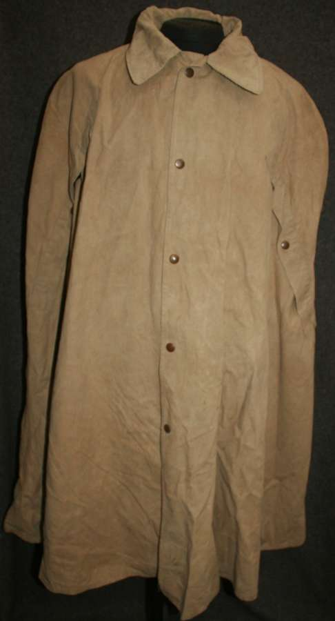 A TAN INDIAN MADE MONSOON CAPE 1944 DATED