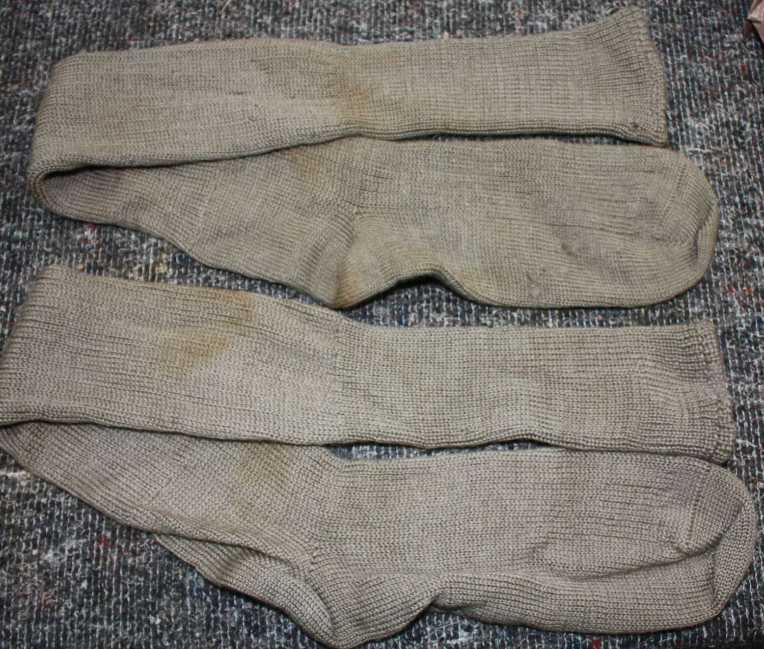 A PAIR OF THE KNEE LENGTH ARMY 1945 DATED SOCKS