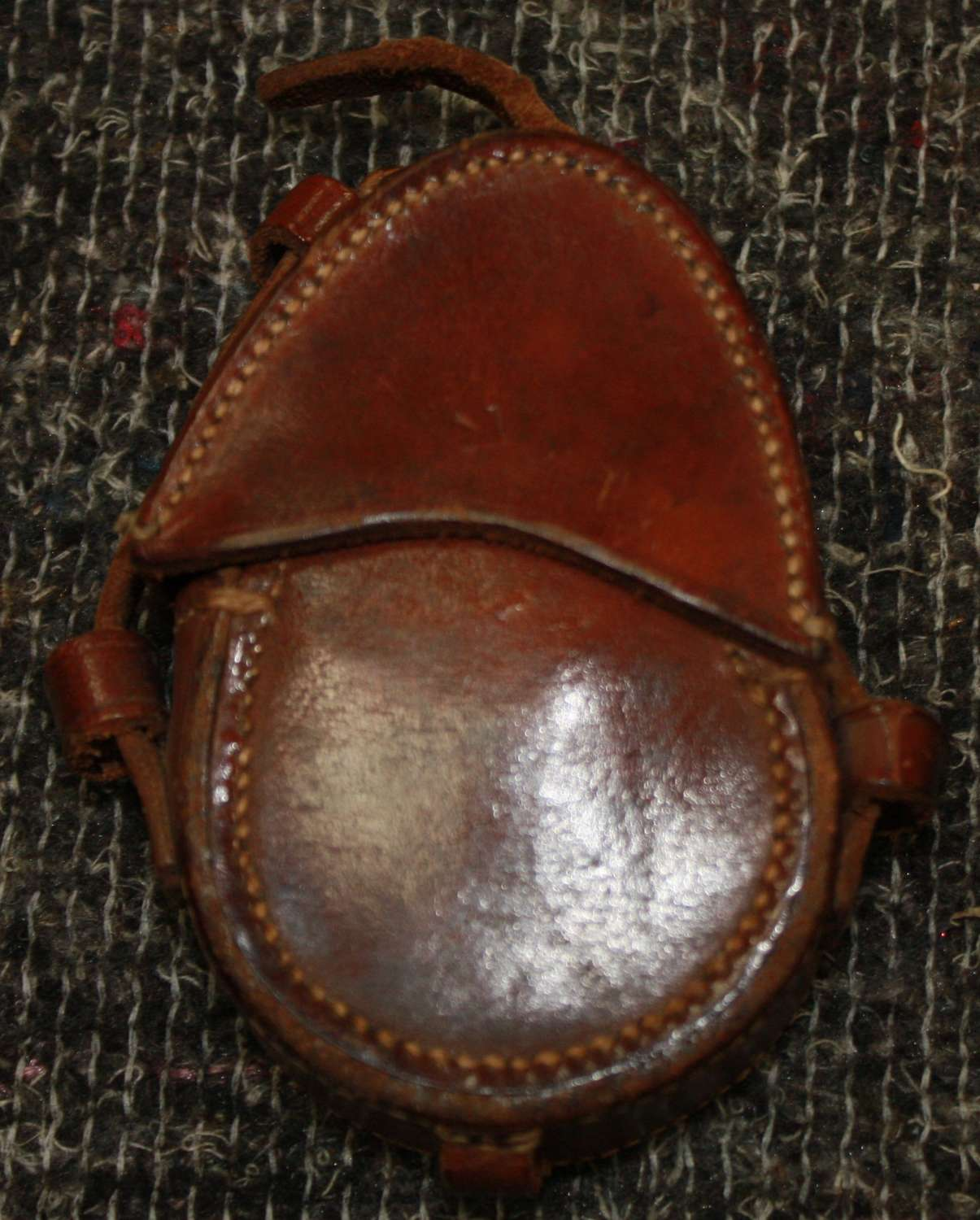A 1917 DATED LEATHER COMPASS POUCH