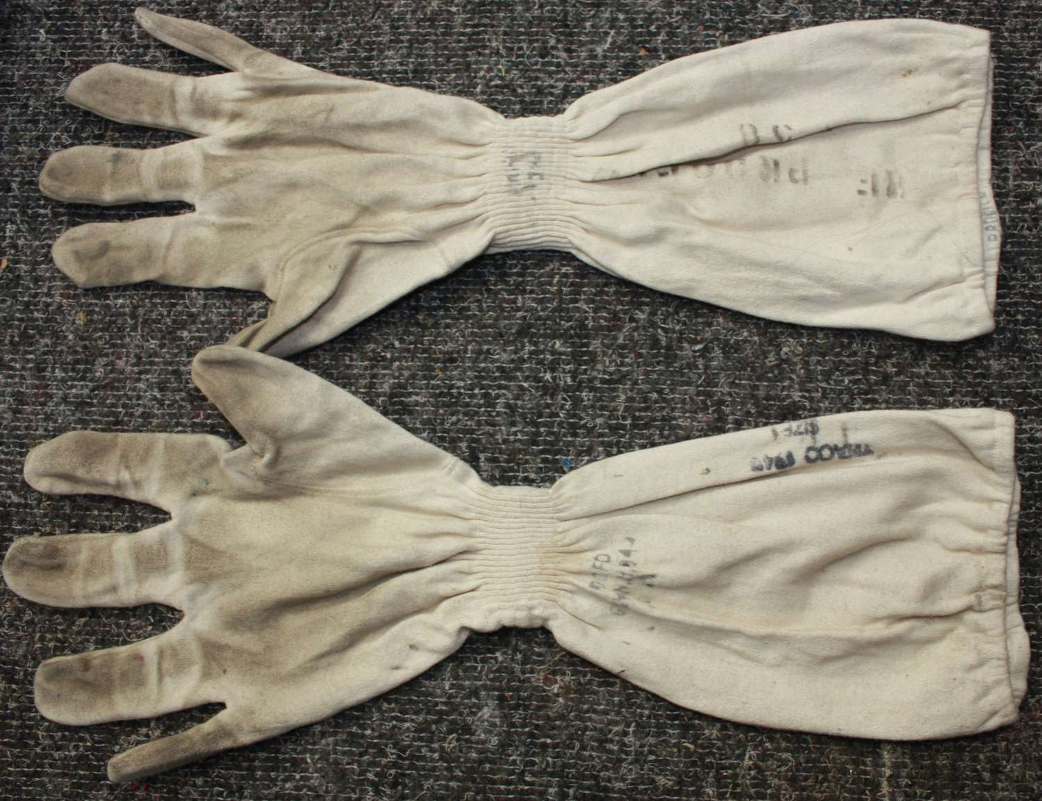 A 1945 DATED RN FLASH GLOVES AND HEAD COVER