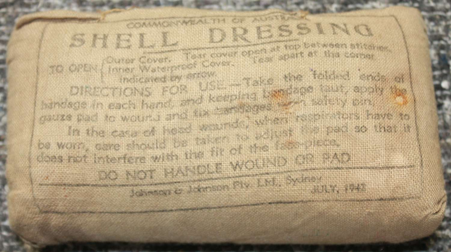 A WWII COMMONWEALTH OF AUSTRALIA SHELL DRESSING